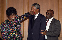 Nelson Mandela is playfully silenced by his wife, Winnie, as they leave their closing press conference in Whitehall.