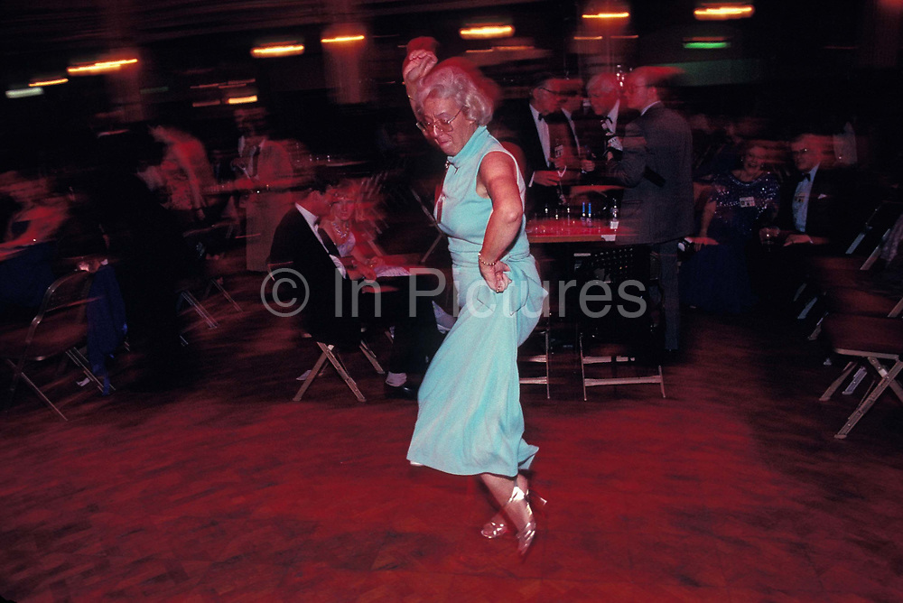 A Conservative Party delegate dances on her own during a party at the 1992 Conservative Party Conference, on 18th March 1992, in Brighton, England. Prime Minister of the day, John Major went on to win the election weeks later and was the fourth consecutive victory for the Tory Party although it was its last outright win until 2015 after Labours 1997 win for Tony Blair.