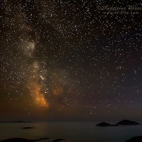 Glowing Milkyway over Derrynane National Park with view on Scariff Island near Caherdaniel, County Kerry, ireland at night / kn002