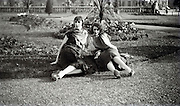 two women posing in a garden 1920s