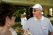 """Leon Boulton and his wife Cindy talk during the Baylor University Medical Center """"transplant reunion"""" in Dallas on Sunday, April 14, 2013. Leon received a heart transplant in November of 2012 and completed a golf tournament t months later. (Cooper Neill/The Dallas Morning News)"""
