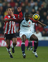 Photo: Javier Garcia/Back Page Images<br />Southampton v Middlesboro, FA Barclays Premiership, St Mary's Stadium 11/12/04<br />Kevin Phillips battles with George Boateng, right