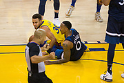 Golden State Warriors guard Stephen Curry (30) looks to the ref after being fouled by Minnesota Timberwolves guard Jeff Teague (0) at Oracle Arena in Oakland, Calif., on January 25, 2018. (Stan Olszewski/Special to S.F. Examiner)