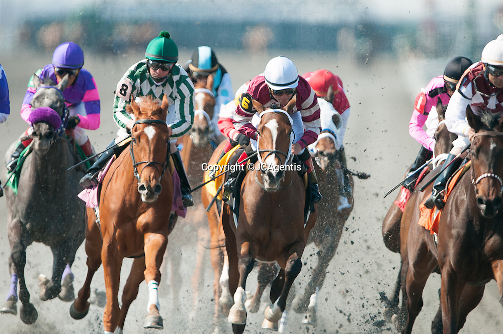 World Class Racing at Keeneland Opening Day, Seventh Race 2013.  Horses racing down the track at Keeneland. Lexington, KY.