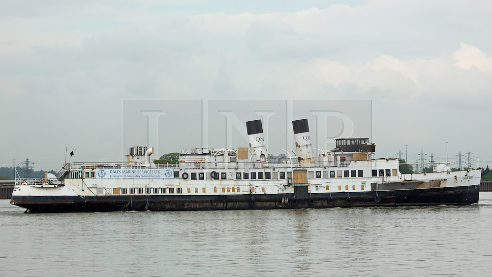 © Licensed to London News Pictures. 11/05/2016. The historic steamer TS Queen Mary pictured leaving Tilbury to finally return home to Scotland. The 1933-built vessel is the Clyde's last and Britain's finest turbine excursion steamer. She came to the Thames in 1981 but has languished in Tilbury docks for years. The Friends of TS Mary Queen was formed with Robbie Coltrane as patron and, following a fundraising campaign, purchased the ship. The ship is now returning home under tow ahead of a full restoration. Credit : Rob Powell/LNP