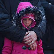 Safe in her fathers arms?Rich Demers holds his daughter Anahya, 7, from Meriden, CT. as they join other members of the public paying their respects at the shrine set up around the towns Christmas tree in Sandy Hook after the mass shootings at Sandy Hook Elementary School, Newtown, Connecticut, USA. 16th December 2012. Photo Tim Clayton