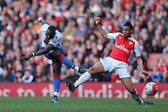 Yannick Bolasie of Crystal Palace shoots to score his sides 1st goal to make it 1-1.Barclays Premier league match, Arsenal v Crystal Palace at the Emirates Stadium in London on Sunday 17th April 2016.<br /> pic by John Patrick Fletcher, Andrew Orchard sports photography.