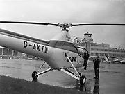Helicopter, Westland Widgeon Arrives Helicopter, Westland Widgeon Arrives Air Display at Weston, Leixlip, Co. Kildare .08/06/1957 . All air craft had to be presented to customs in Dublin Airport