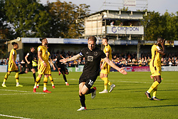 Port Vale's Tom Conlon (centre) celebrates after scoring his sides third goal of the game during the Sky Bet League Two match at Borough Sports Ground, Sutton. Picture date: Saturday October 9, 2021.