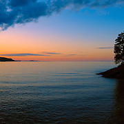 """""""Chasing Sunset""""<br /> <br /> If you love beautiful and peaceful sunsets, then this one is for you! A lovely sunset and silhouette on the shores of Lake Superior!"""