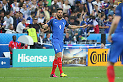 France Forward Olivier Giroud calms his side after his goal during the Group A Euro 2016 match between France and Romania at the Stade de France, Saint-Denis, Paris, France on 10 June 2016. Photo by Phil Duncan.