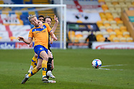 Mansfield Town Kellan Gordon (12) Scunthorpe United Alfie Beestin (22) battles for possession during the EFL Sky Bet League 2 match between Mansfield Town and Scunthorpe United at the One Call Stadium, Mansfield, England on 20 April 2021.