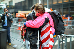 © Licensed to London News Pictures. 09/11/2016. New York CIty, USA. A pro-Clinton supporter wearing an American flag cries while gathering outside Trump Tower in New York City, on Wednesday, 9 November 2016 following the presidential election won by Donald Trump. Photo credit: Tolga Akmen/LNP