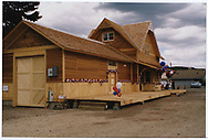 3/4 view of rebuilt Dolores depot, designed by Dick Dorman.  It is decorated for the rededication ceremony.<br /> Galloping Goose Historical Socilety  Dolores, CO  6/29/1991