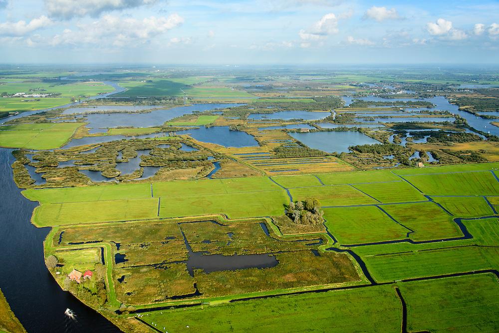 Nederland, Friesland, Alde Feanen, 10-10-2014;<br /> De Oude Venen, met geisoleerde boerderij. Eernewoude rechts aan de horizon. Links Prinses Margrietkanaal.<br /> The old peatlands, Frisian peatland and bog, nature reserve.<br /> luchtfoto (toeslag op standard tarieven);<br /> aerial photo (additional fee required);<br /> copyright foto/photo Siebe Swart