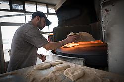 20 February 2020, Za'atari, Jordan: Mohammad Abu Bakar bakes bread in a bakery in Za'atari, Jordan.