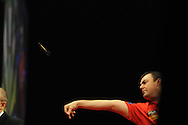 Wes Newton (Eng)  in action during his match against  Phil Taylor (Eng).McCoy's Premier league darts, week 7 event at the Motorpoint Arena in Cardiff, South Wales on Thursday 21st March 2013. pic by Andrew Orchard, Andrew Orchard sports photography,