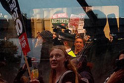 © Licensed to London News Pictures. 27/05/2015. Westminster, UK. UKIP MP Douglas Carswell leaving Westminster in a police van after being surrounded by demonstrators taking part in an End Austerity Now protest outside St James's Tube station in London. Activists are demonstrating against the current conservative government and planned spending cuts. At a previous demonstration by the same group  a war memorial on Whitehall was defaced. Photo credit: Tolga Akmen/LNP