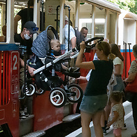 Passengers get on board a train at the Children's Railway in Budapest, Hungary on Aug. 26, 2020. ATTILA VOLGYI