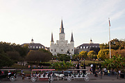 Jackson Square park, with horse and carts awaiting riders,French Quarter, New Orleans, Louisiana, USA. walking down the street in the French Quarter,