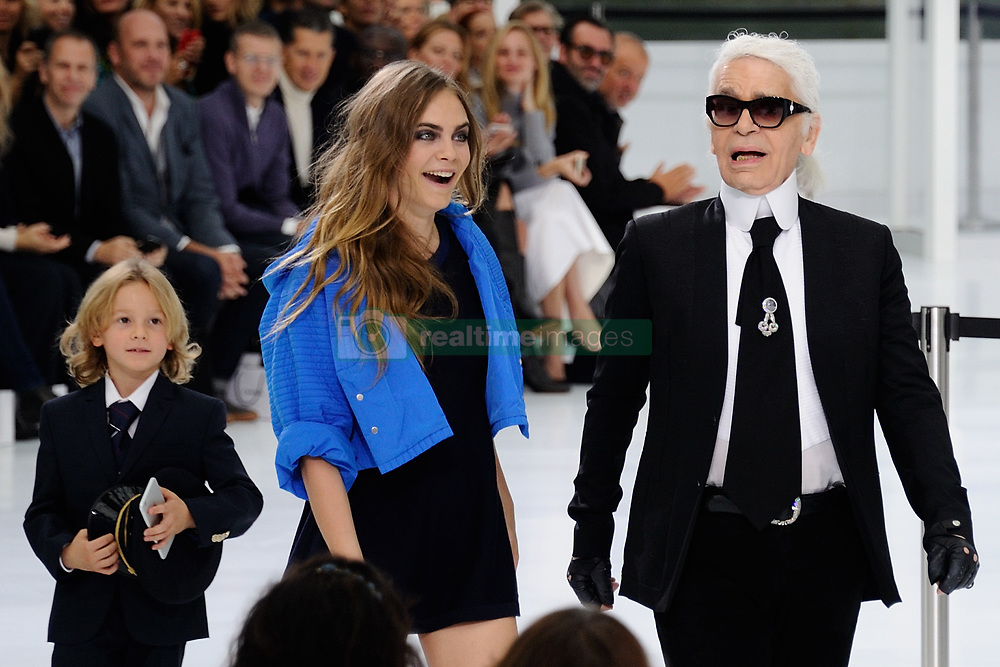 Designer Karl Lagerfeld with Cara Delevingne and his godson Hudson Kroenig makes an appearance after his Spring-Summer 2016 Women's collection presentation held at the Grand-Palais in Paris, France, on october 06, 2015. Photo by Aurore Marechal/ABACAPRESS.COM