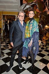 Left to right, DAVID DOWNTON and ERIN O'CONNOR at a party to celebrate theunveiling of the Claridge's Christmas Tree designed by Christopher Bailey for Burberryheld at Claridge's, Brook Street, London on 18th November 2015.