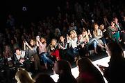TORONTO, ON - MARCH 15: Front row fans take photos during the Ellie Mae show Toronto Fashion Week in Toronto, Ontario. Toronto Star/Todd Korol