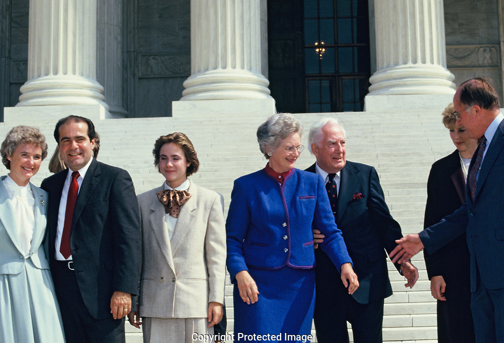 Antonin Gregory Scalia on the day that he became an associate justice of the Supreme Court with his wife,  Maureen Scalia and daughter.  Also, Supreme Court chief Justice Warren Burger, and the new Supreme Court Chief Justice William William Hubbs Rehnquist <br />Photo by Dennis Brack