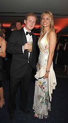 GUY PELLY and HOLLY BRANSON at the 2008 Boodles Boxing Ball in aid of the charity Starlight held at the Royal Lancaster Hotel, London on 7th June 2008.<br /> <br /> NON EXCLUSIVE - WORLD RIGHTS