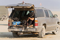 One of the fascinating things about this event was the ability to drive wherever you want. Some folks drove right out to the large parties and then other people urinated on their vehicles. At a regular burn you can't drive except to your camp and back out. This reduces dust and injuries. - https://Duncan.co/Burning-Man-2021