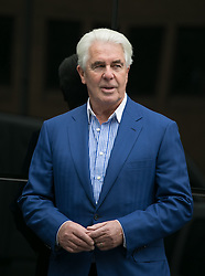 Max Clifford trial verdict update. Publicist Max Clifford leaves court for a lunch break at Southwark Crown Court, London, United Kingdom. Wednesday, 23rd April 2014. Picture by Daniel Leal-Olivas / i-Images