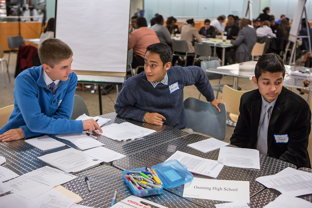 Purchase, NY – 31 October 2014. Tim Eiden, Kiran  Narsipur, and Sami Rajput (L to R) from Ossining High School discuss their case. The Business Skills Olympics was founded by the African American Men of Westchester, is sponsored and facilitated by Morgan Stanley, and is open to high school teams in Westchester County.