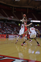 26 February 2009: Monica Rogers releases a 15 foot shot over defender Emily Hanley. The Braves of Bradley  and the Illinois State Redbirds battled it out on Doug Collins Court inside Redbird Arena on the campus of Illinois State University, Normal Il.