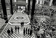 An aerial view of a group of people standing on a checkered floor