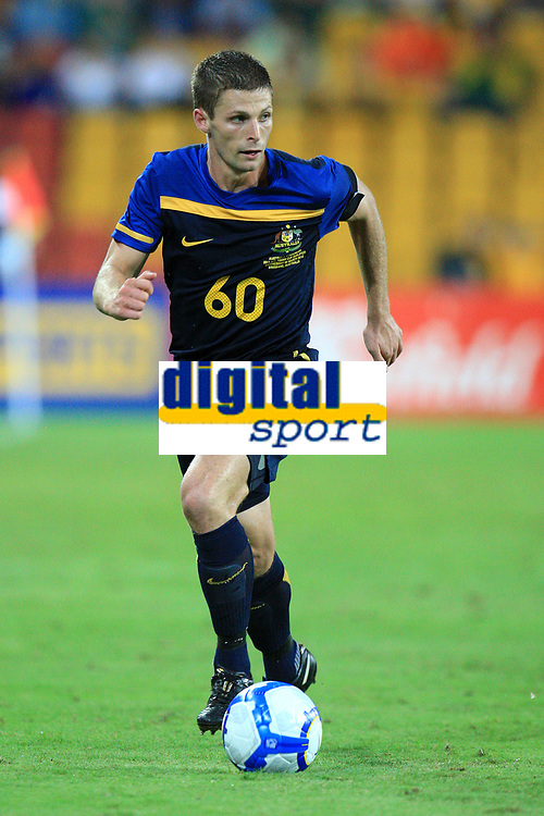"""AUSTRALIA V INDONESIA - 3RD MARCH 2010. Action from the Asian Cup qualifier between the Australian """"Qantas Socceroo's"""" v Indonesia, played at Suncorp Stadium in Brisbane, Queensland, Australia. PHOTO : SCOTT POWICK / SMP IMAGES / DPPI - SHANNON COLE (AUS)"""