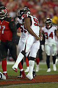 Atlanta Falcons rookie defensive end Takkarist McKinley (98) jumps and yells out as he celebrates after the Falcons get a quarterback sack for a loss of 3 yards on a third down play in the third quarter and forcing a Tampa Bay Buccaneers punt during the 2017 NFL week 15 regular season football game against the Tampa Bay Buccaneers, Monday, Dec. 18, 2017 in Tampa, Fla. The Falcons won the game 24-21. (©Paul Anthony Spinelli)