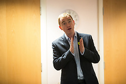 © Licensed to London News Pictures . 24/11/2015 . Oldham , UK .  Liberal Democrat leader TIM FARRON talking to children from years 5 and 6 whilst campaigning at St Thomas CofE Primary School in the seat of Oldham West and Royton , with candidate Jane Brophy , in a by-election triggered by the death of MP Michael Meacher . Photo credit : Joel Goodman/LNP