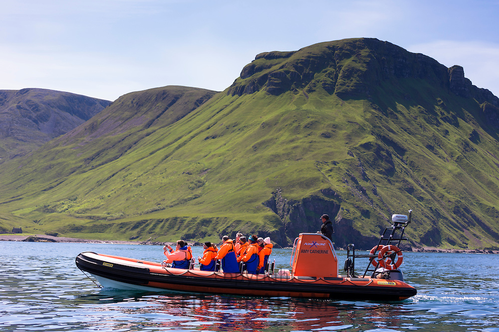 Rigid inflatable tourist sealwatching boat trip on visit to Isle of Canna part of the Inner Hebrides and Western Isles in West Coast of Scotland