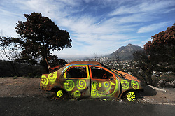 South Africa - Cape Town - 8 June 2020 - The burned out shell of a car that caught fire in a fire that swept over Lions Head, got graffitied. Photographer: Armand Hough/African News Agency(ANA)