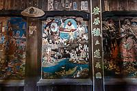 Heaven and Hell Mural at Taisanji - Temple No. 52 of the Shikoku 88 temple pilgrimage. The main hall which was rebuilt in 1305,has been designated as a National Treasure, while the Niomon Gate is an important national cultural property.  Taisanji has wonderful views of the Shikoku Mountains.  The main bhall is one of the more spectacular on the pilgrimage and said to have been built in one day by a merchant who was miraculously delivered from a storm while sailing with a cargo on the Inland Sea.  An unforgettable feature of Taisan-ji is the bell tower with its paintings of heaven and shocking picture of hell.
