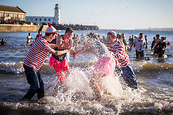 © Licensed to London News Pictures. 01/01/2019. Scarborough UK. Swimmers brave the cold sea water on New Years day 2019 in Scarborough on the Yorkshire coast. Photo credit: Andrew McCaren/LNP