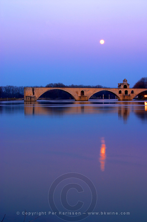 The Pont Saint St Benezet bridge in Avignon on the Rhone at sunset with moon, Vaucluse, Rhone, Provence, France