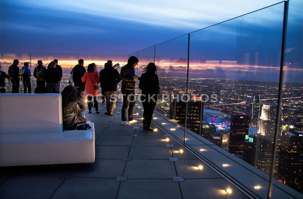 Tourists Looking at Los Angeles Skyline at Night