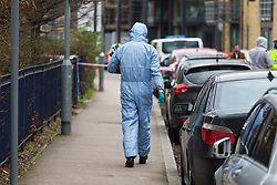 Barking, London - The scene at a housing estate on Abbey Road in Barking, London where a 19 year old died of stab wounds on 3 February 2018 despite attempts by paramedics to save his life. Scotland Yard's murder squad are investigating and have made no arrests so far. PICTURED: A forensics investigator arrives at the scene. February 04 2018.