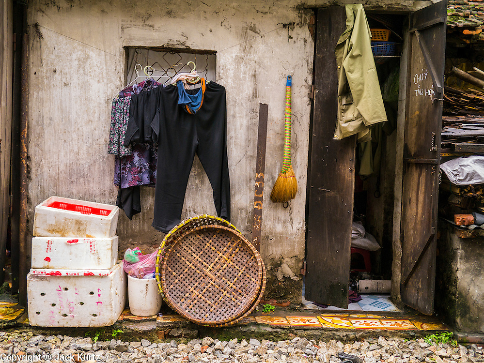 07 APRIL 2012 - HANOI, VIETNAM: Clothes hanging out to dry in front of a home in Hanoi, the capital of Vietnam. Hanoi is one of the oldest cities in Southeast Asia. It was established in 1010 A.D.   PHOTO BY JACK KURTZ
