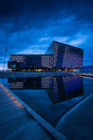 Blue hour reflecting color in the glass windows of the Harpa Building in downtown Reykjavik, Iceland
