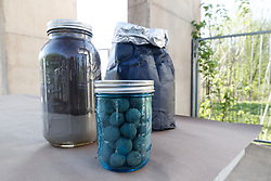 Jars of seed bombs at Great American Seed Bomb event harnessing volunteers to plant natives prairie and wildflower seeds in North Texas prairies, Great Trinity Forest, Dallas, Texas, USA