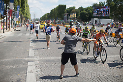 In the hot weather the riders take new bottles in almost every lap during the La Course, a 89 km road race in Paris on July 24, 2016 in France.
