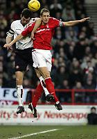 Fotball<br /> Championship England 2004/05<br /> Nottingham Forest v Sunderland<br /> 28. desember 2004<br /> Foto: Digitalsport<br /> NORWAY ONLY<br /> Nottingham's Michael Dawson (R) and Gary Breen go to header the ball