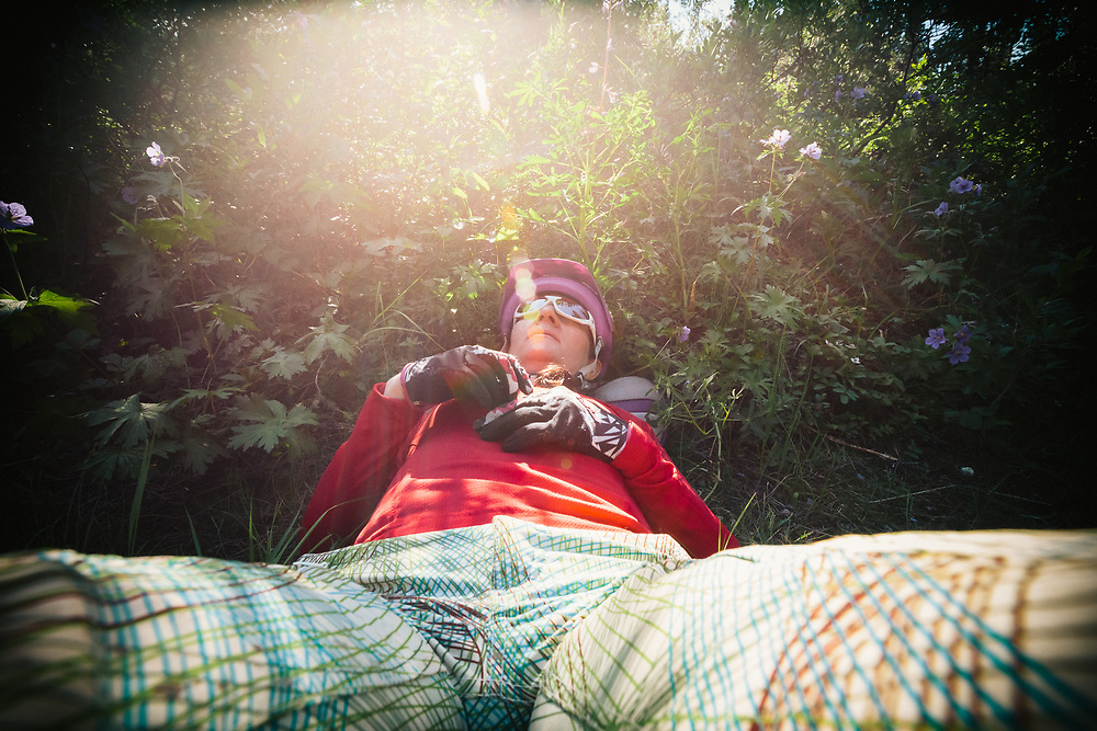 Heather Goodrich takes a rest after crashing during a mountain bike ride in Alaska.